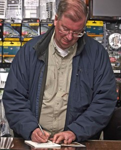 Dr Ian D Martin Signing A Copy of His Fly Fishing The Grand River Book